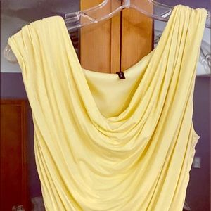 Soft yellow blouse.